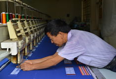Fixing An Embroidery  Machine Royalty Free Stock Image