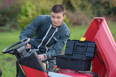 Fixing expensive lawn mower Royalty Free Stock Photography