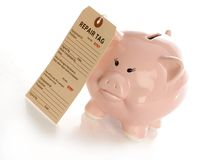 Fixing financial problems. Repair tag hanging on pink piggy bank with reflection on white background Royalty Free Stock Image