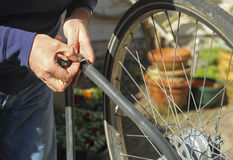 Fixing flat bike tire Royalty Free Stock Image