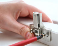 Fixing furniture hinges, using, a Phillips screwdriver. stock photos