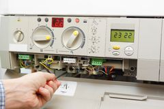 Fixing gas furnace Stock Photography