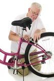 Fixing Her Bike's Brakes stock photos
