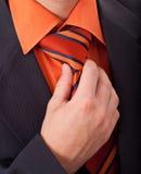 Fixing his tie Stock Photo