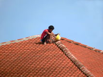 Fixing A Leaky Roof Royalty Free Stock Images