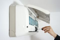 Fixing and maintaining air conditioning system.  Stock Photos