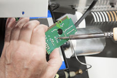 Fixing motherboard with screwdriver Stock Photo