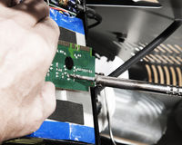 Fixing motherboard with screwdriver Royalty Free Stock Images