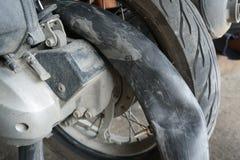 Fixing motorbike rear wheel. In Thailand service center Stock Photos