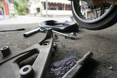 Fixing motorbike rear wheel. In Thailand service center Royalty Free Stock Photography