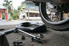 Fixing motorbike rear wheel. In Thailand service center Stock Photo