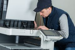 Fixing an office printer. Work royalty free stock photo