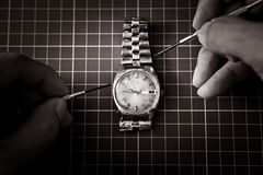 Fixing an Old watch. Fixing and repairing an old mechanical watch Royalty Free Stock Images