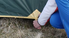 Fixing the outer layer of the tent stock footage