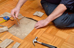 Fixing Parquet in the Apartment. Fixing wooden parquet in the apartment damaged by moisture or water Stock Photo