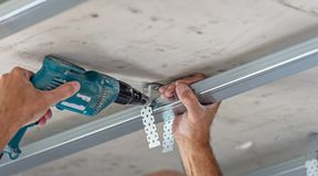 Fixing plasterboard sheets. Fixing plasterboard sheets to the frame Stock Photo