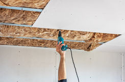 Fixing plasterboard sheets. Royalty Free Stock Photos