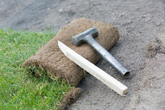 Fixing rolled sod grass turf on soil Royalty Free Stock Photos