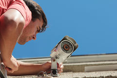 Fixing the security camera Stock Photography