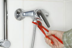 Fixing a shower pipe Royalty Free Stock Image