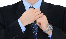 Fixing the tie Stock Photo