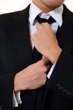 Fixing tie Stock Photo