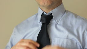 Fixing a tie Stock Image