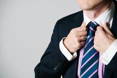 Fixing a tie. Stock Image