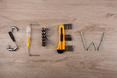 Fixing tools lay in word on wooden table Stock Photos