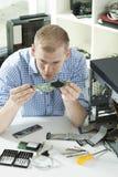 Fixing up the computer Stock Photos