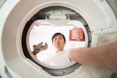 Fixing washing machine Royalty Free Stock Photography