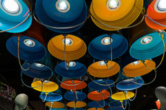Fixtures in the form of multi-colored buckets.  Royalty Free Stock Photography