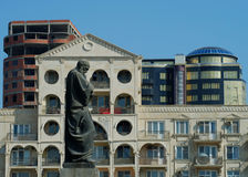 Fizuli Contemplates a Modern World. Mohammed ibn Suleiman Fizuli (1492-1556) stands in Baku and slowly gets swamped in modern architecture Royalty Free Stock Photos