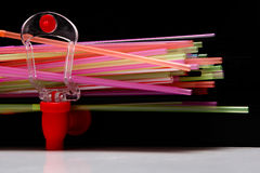 Fizz keeper. And few straws on a black background royalty free stock photo