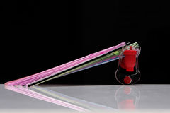 Fizz keeper. And few straws on a black background royalty free stock photography