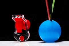 Fizz keeper. And few straws in a blue plastic ball stock image