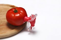 Fizz keeper. Red tomato and a fizz keeper on a wooden trencher royalty free stock image