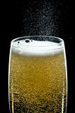 Fizzing Glass of Champagne Stock Photo