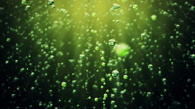 Fizzy drink bubbles against dark green. Video footage stock footage