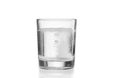 Fizzy tablet in glass of water. Stock Photos