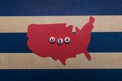 Fjärdedel av affischen USA för ferie för Juli 4 den pappers- konstkort Royaltyfria Foton