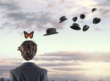 Fjäril och hattar Arkivfoto