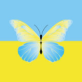 Fjäril på flaggan av Ukraina Arkivbilder