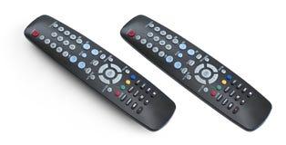 Fjärrkontroll för TVuppsättning som isoleras på vit med den snabba banan Arkivbilder