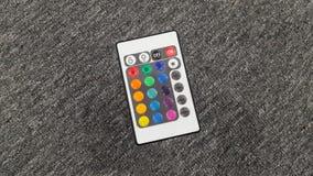 fjärrkontroll som isoleras på grå bakgrund Fotografering för Bildbyråer
