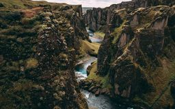 Fjadrargljufur canyon in iceland with blue water and cloudy sky. really beautiful canyon stock photos