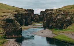 Fjadrargljufur canyon in iceland with blue water and cloudy sky. really beautiful canyon royalty free stock image