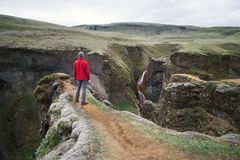 Tourist contemplates canyon in Iceland Royalty Free Stock Photo