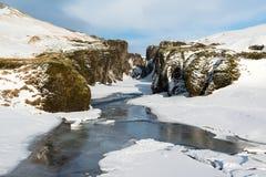 Fjadrargljufur kanjon och Fjadra flod på vintern, Island Royaltyfria Bilder