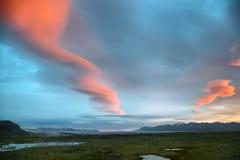 Fjallsarlon Glacial Lagoon. Sunrise at Fjallsarlon Glacial Lagoon of Vatnajokull glacier with majestic lenticulars clouds, Iceland stock photo